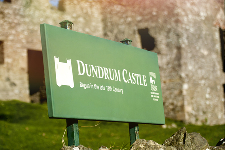 Dundrum Castle sign. Situated above the town of Dundrum, County Down in Northern Ireland.