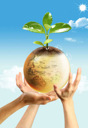 Three hands and a big yellow earth on sky background photo