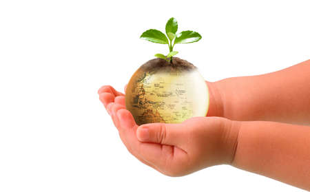 Nice combination with babies hand and Earth Stock Photo
