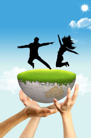 Three hands holding Earth where are dancing boy and a girl