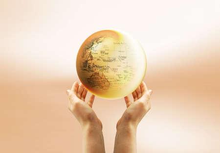 erde gelb: Gelbe Erde in den Himmel und eine hand
