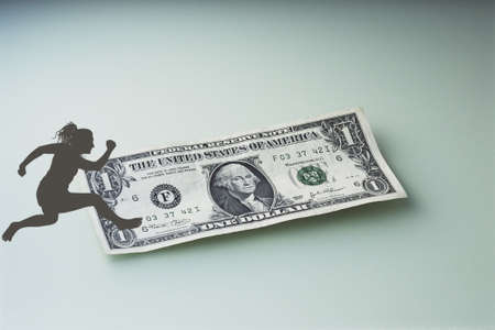 In this picture you can see a dollar and a sportsman Stock Photo - 6348429