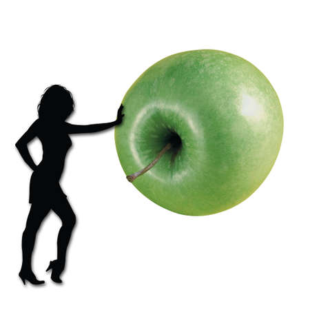 Combination with a girl and a green apple Stock Photo