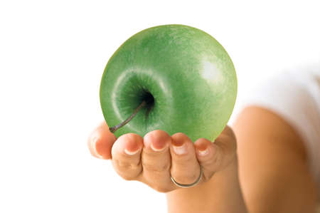 Combination with hand and a green apple