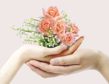 Romantic bouquet and hands photo