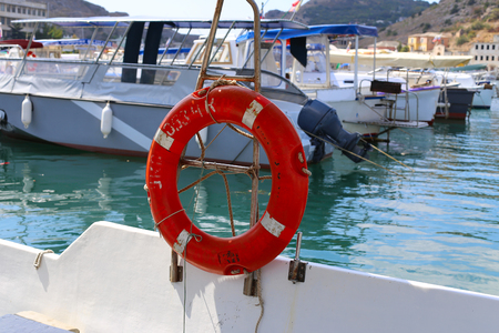 Red lifebuoy attached to the ship railing