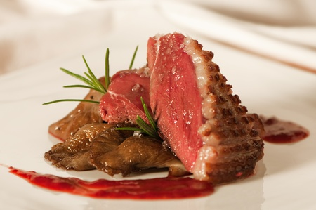 Duck breast with raspberry sauce and mushrooms Stock Photo