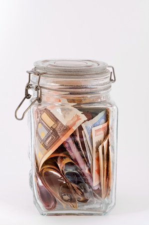 Money saved meditate in a glass jar photo
