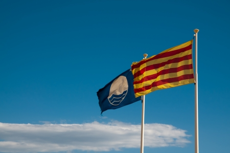 Flag of Catalonia and blue flag awarded by European Union photo