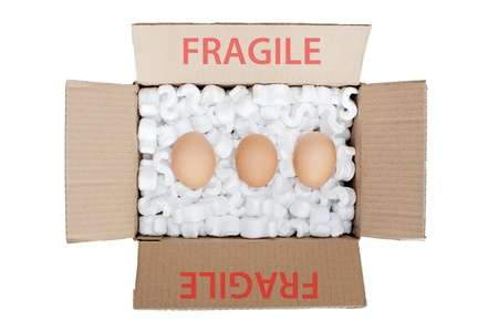 Eggs in a box with polystyrene photo