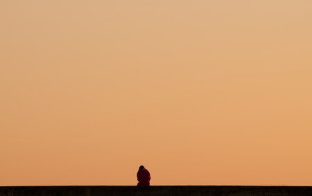 Single person relaxing at sunset photo