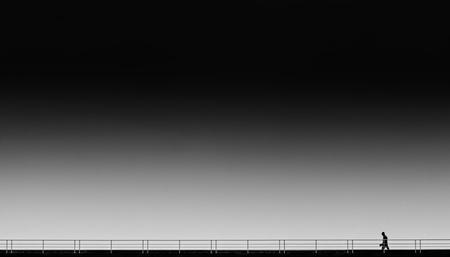 loner walking black and white Stock Photo - 17105020