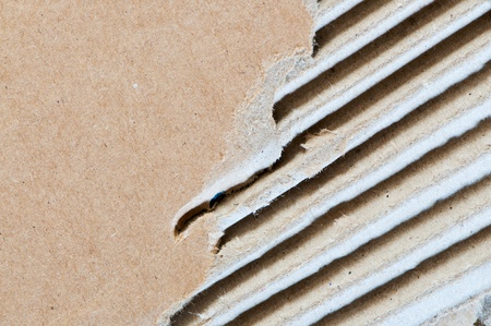 Piece of corrugated cardboard with torn edges photo