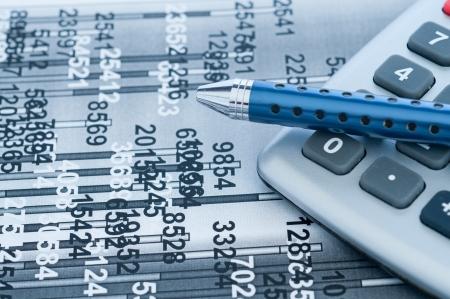 financial analysis calculator and pen