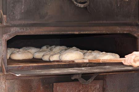 ingest: Artisan baker working in traditional fair