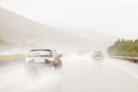 Cars on a road with storm Stock Photo