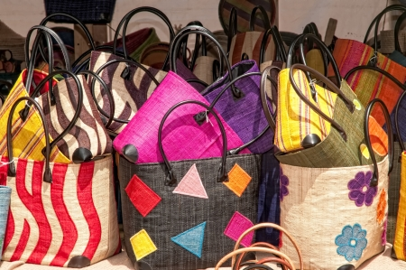 Handbags exposed for sale at traditional market Stock Photo
