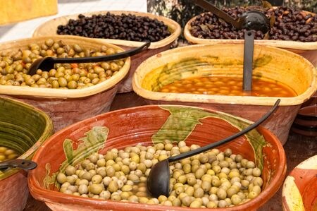 Assortment of olives in a traditional market photo