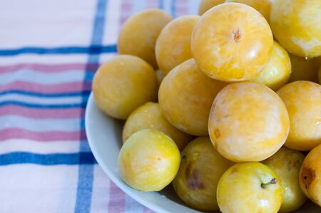 Detail of a plate with white plums photo