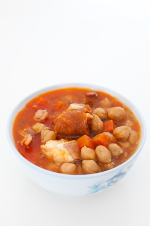 Typical chickpea stew with chorizo and spices. photo