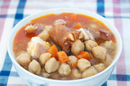 Typical chickpea stew with chorizo and spices photo