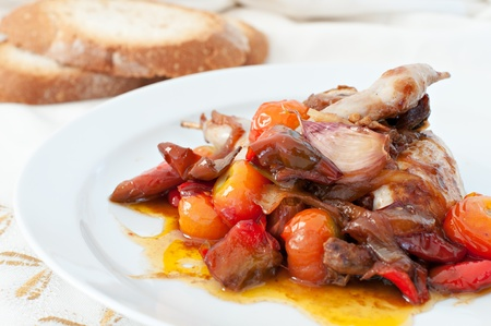 Quail dish cooked with peppers and tomatoes Stock Photo