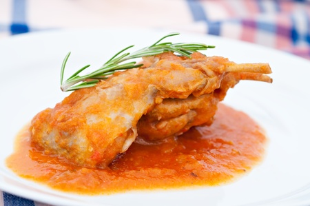 Quail dish cooked with peppers and tomatoes photo