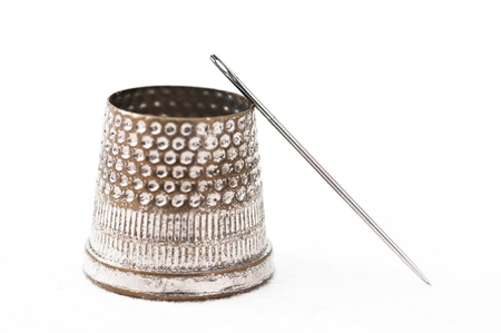 Detail of a thimble and needle designer photo