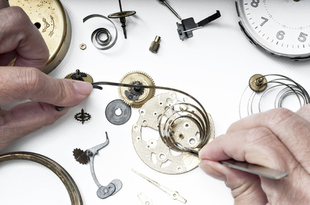 hands on pocket: Special tools for repair of clocks  Stock Photo
