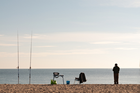 A fisherman on the shore photo