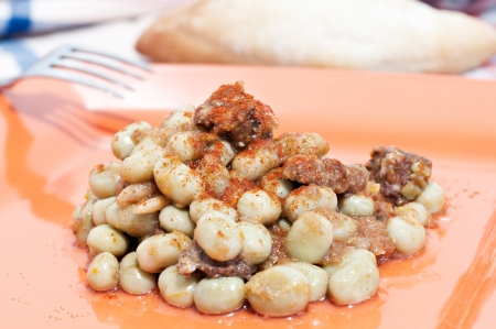 Plate of beans with sausage photo