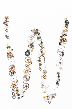 detail alphabet W formed by clock parts photo