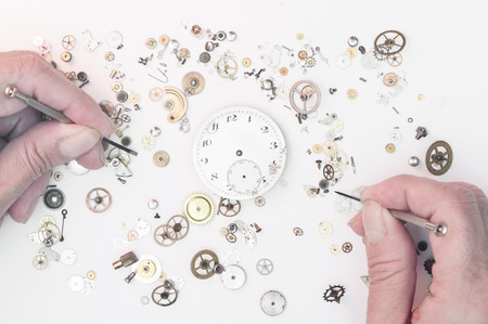 Man repairing a clock
