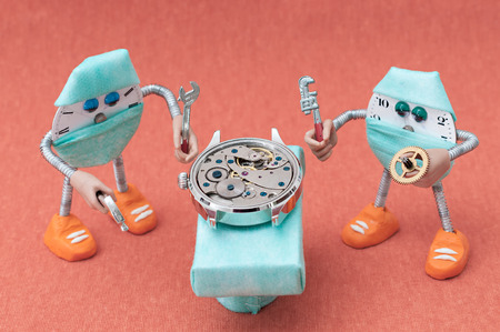 Robots with Detail of clock parts for restoration photo