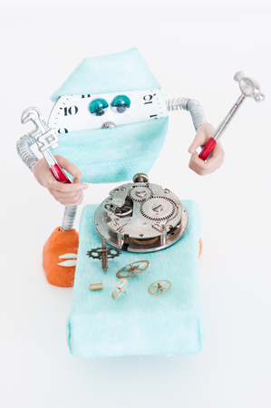 Robot with Special tools for repair of clocks  photo