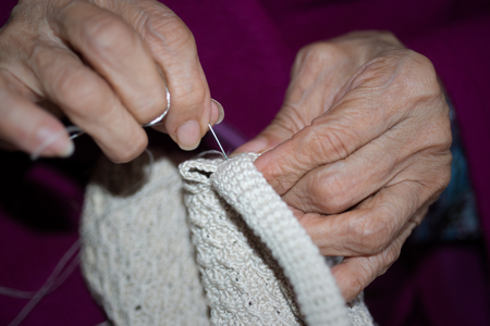 sewing cotton: Detail of the hands of a person sewing Stock Photo