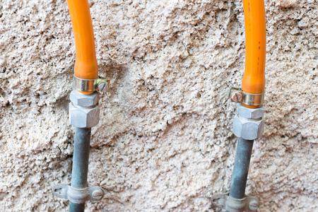 butane: Detail gums exchange for a bottle of butane Stock Photo