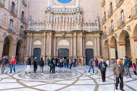 ABBEY OF MONTSERRAT - BARCELONA - APRIL 2015. Overview of the courtyard and the facade decorated with sculptural reliefs of Joan Rebull Editorial