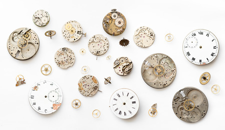 hands on pocket: Detail of clock parts for restoration Stock Photo