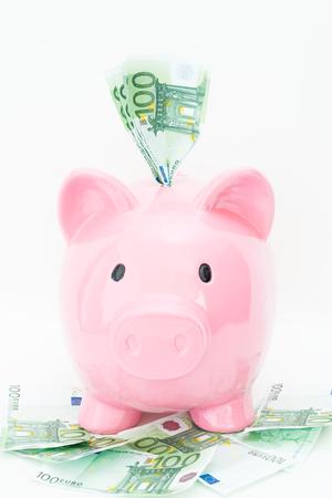 banconote euro: Detail of a piggy bank and several euro banknotes
