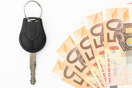 simulating: Keys and money simulating loan for buying a car