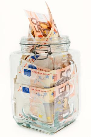 euro banknotes: Detail of a piggy bank and several euro banknotes