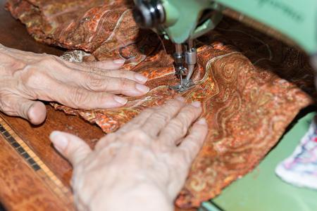 hassock: Details of a dressmaker weaving a cushion