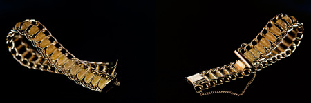 Detail of a gold bracelet on black background