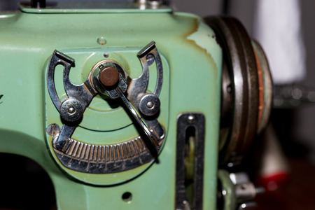 Details of an old woman with a sewing machine