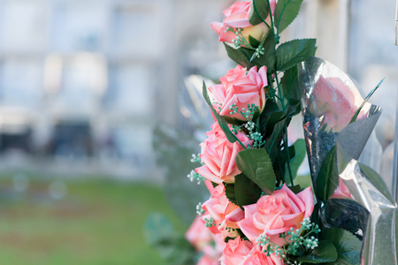 Detail of a bouquet of flowers in a cemetery
