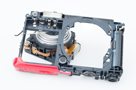 Dismantling of digital cameras for recycling Stock Photo