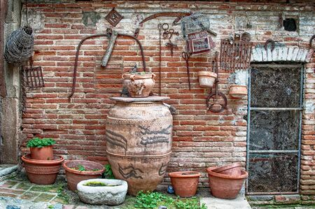 Typical country house entrance with tools for tillage