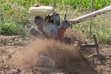 Detail of a monocultor preparing a field to be able to sow it