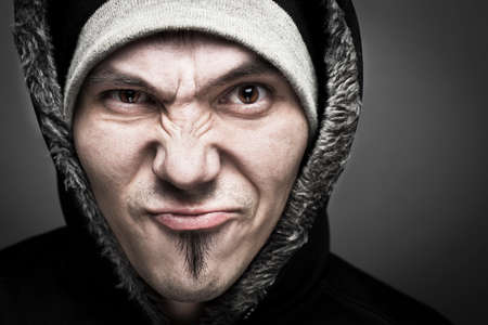 hooded sweatshirt: Serious angry man with hooded sweatshirt.